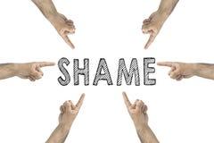 Klandra dig Direktanslutet eller offentligt dra skam över begrepp händer som pekar till text: skam arkivfoton