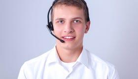 Klantenondersteuningsexploitant met een hoofdtelefoon op witte achtergrond Royalty-vrije Stock Afbeeldingen