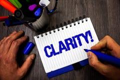 Klarhet för handskrifttexthandstil För säkerhetprecision för begrepp menande håll för håll för man för exakthet för stordia för C royaltyfria bilder