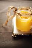 Klarujący masło w słoju Obraz Royalty Free