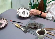 Klasse-gemalte Platten des Trainings Meister stockbild