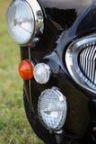 Klassiek Brits autokoplamp en traliewerk Royalty-vrije Stock Fotografie