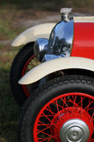 Klassiek Brits autowiel, koplamp en traliewerk Stock Foto's