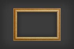 Klassiek houten die kader op zwarte muur wordt geïsoleerd Royalty-vrije Stock Foto's