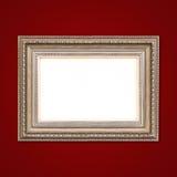 Klassiek houten kader op rode muur Royalty-vrije Stock Foto's