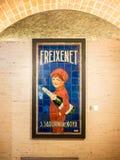 Klassieke Freixenet-Jongen met de Hoed en de Cava fles Royalty-vrije Stock Fotografie
