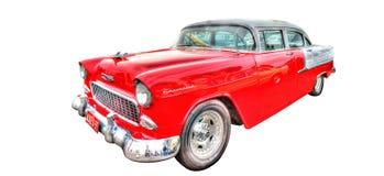 Klassieke jaren '50 Amerikaanse die auto op witte achtergrond wordt geïsoleerd Royalty-vrije Stock Foto's