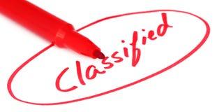 Klassifiziert geschrieben in rote Buchstaben lizenzfreie stockbilder