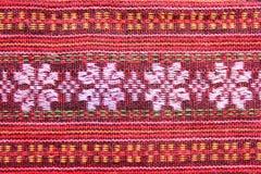 Klassische Blume im Makromuster auf thailändischen Sarongen Lizenzfreies Stockbild