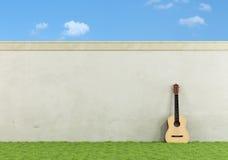 Klassische Gitarre in einem Garten Stockfotografie