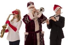 Klassische Musik des Spiels mit drei Musikern lizenzfreie stockbilder