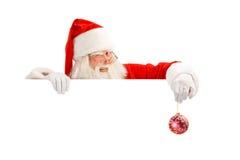Klassischer Santa Holding ein Zeichen blinzeln Lizenzfreies Stockfoto