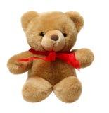 Klassischer Teddybär mit rotem Bogen Lizenzfreies Stockfoto