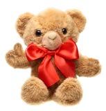 Klassischer Teddybär mit rotem Bogen Stockfotos