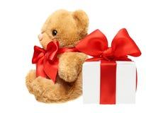 Klassischer Teddybär mit rotem Bogen Stockbild
