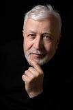 Klassisches Porträt eines Mannes auf einem schwarzen Hintergrund 1 Stockfotos