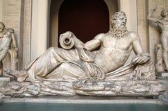 Skulptur av Neptun i det Vatican museet Fotografering för Bildbyråer