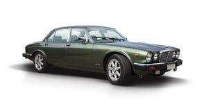 Klassisk Jaguar XJ serie som isoleras på vit Fotografering för Bildbyråer