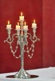 Klassisk ljusstake för silver som isoleras på rött Arkivfoton