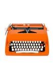 klassisk orange skrivmaskin Fotografering för Bildbyråer