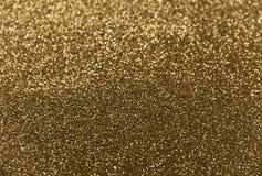 Klassisk skinande guld blänker bakgrund för formgivare royaltyfria foton