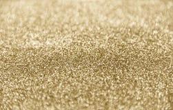 Klassisk skinande guld blänker bakgrund med den selektiva fokusen arkivfoton