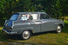 Klassisk svensk bil parkerade Saab 95 Fotografering för Bildbyråer