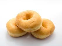 Klassiska donuts på med bakgrund, inget socker Arkivfoto