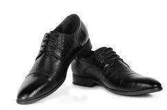 Klassiska par av svarta skor för läderman` s Arkivfoto