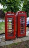 Klassiska röda telefonaskar Arkivfoton