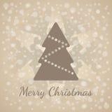 Klassiskt hälsningkort för glad jul Brunt xmas-trädsymbol med stjärna- och snöflingavektorn Royaltyfri Bild