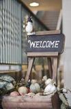 Klassiskt välkomnande tecken Fotografering för Bildbyråer