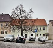 Klasterec nad Ohri, Czech republic - February 17, 2018: cars, tree and historical houses on Namesti Dr. Benese pavement square dur Royalty Free Stock Images