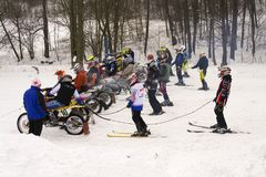Motorcycle skijoring racers prepare for ride. KLASTEREC NAD ORLICI, CZECH REPUBLIC - JANUARY 29: Motorcycle skijoring racers prepare for ride on January 29, 2017 Stock Photography