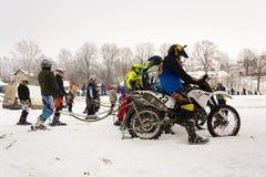 Motorcycle skijoring racers prepare for ride. KLASTEREC NAD ORLICI, CZECH REPUBLIC - JANUARY 29: Motorcycle skijoring racers prepare for ride on January 29, 2017 Stock Photos