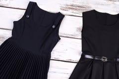Klasycznej szkoły czerń ubiera dla dziewczyn Obraz Stock