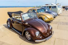 Klasyczni ściga pojazdy przy plażą Zdjęcia Stock