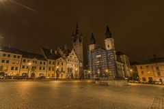 Klatovy old square in autumn night with orange sky. And lights in streets royalty free stock photo