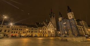 Klatovy old square in autumn night with orange sky. And lights in streets stock photography