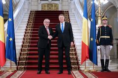 KLAUS IOHANNIS AND JEAN-CLAUDE JUNCKER MEETING AT COTROCENI PALACE. Romanian President Klaus Iohannis, center and Jean-Claude Juncker the President of the royalty free stock images