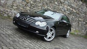 Klausenburg Napoca/Rumänien 7. April 2017: Coupé Mercedes Benzs W209 - Jahr 2005, Eleganzausrüstung, 19-Zoll-Räder, Profilansicht Stockbild
