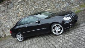 Klausenburg Napoca/Rumänien 7. April 2017: Coupé Mercedes Benzs W209 - Jahr 2005, Eleganzausrüstung, 19-Zoll-Räder, Profilansicht Lizenzfreie Stockfotos
