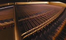 Klavier-Drähte Stockfoto