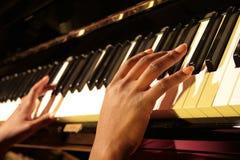 Klavier-Hände Stockbild
