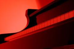 Klavier im Rot Stockfotos