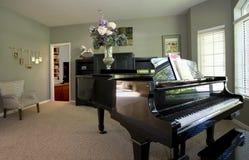 Klavier im Wohnhaus Stockbild