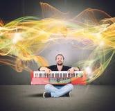 Klavier und goldene Wellen Lizenzfreie Stockbilder