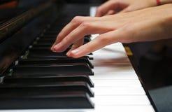 Klavierhand Stockfoto