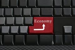 Klawiatura czarna klawiatura i tekst gospodarkę dalej wchodzić do guzika Obraz Stock