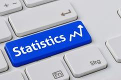 Klawiatura z błękitnym guzikiem - statystyki Fotografia Stock